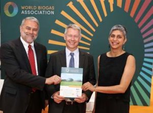 Imags shows: David Newman, President, World Biogas Association (left) and Dr Sarika Jain, author (right) present the Global Potential of Biogas report to Niclas Svenningsen at the World Biogas Summit in Birmingham, UK on 3rd July 2019