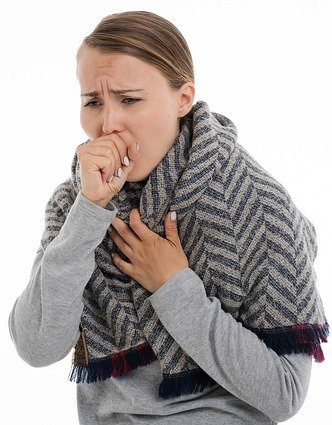 A Lady coughing due to air pollution